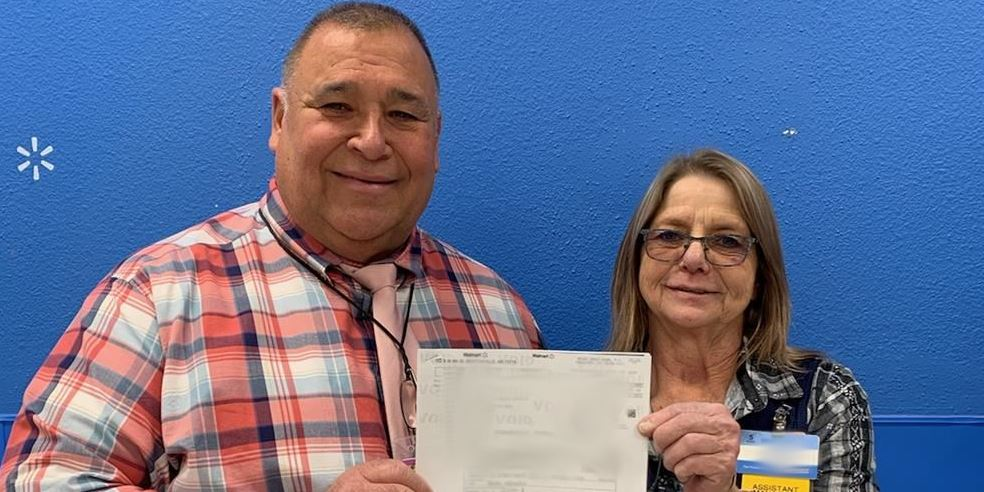 Picture of Mr. Pico and a local Walmart representative holding check